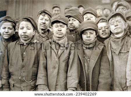 "Child laborers portrayed by Lewis Hine in 1911. Dust covered Breaker boys at Pennsylvania Coal mine, used hammers to ""clean"" the coal, separating slate rock from the mined coal. - stock photo"