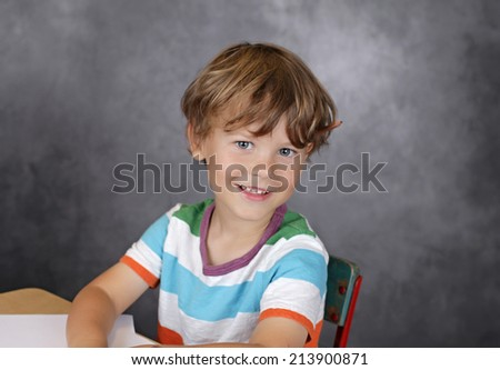 Child laughing, with blank page, learning, school or education concept - stock photo