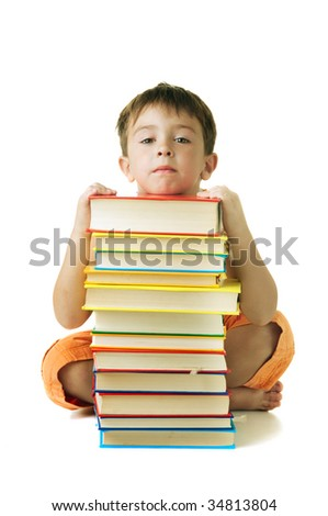 Child leaning on a books stack