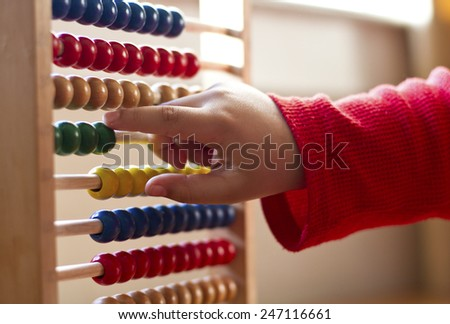 Child  learning counts on  a Abacus - stock photo