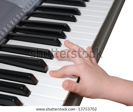 Child learns how to play piano - stock photo