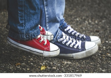 child legs in red shoes - stock photo