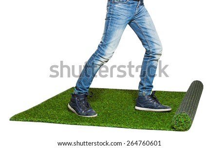 child legs walking on artificial grass isolated on white - stock photo