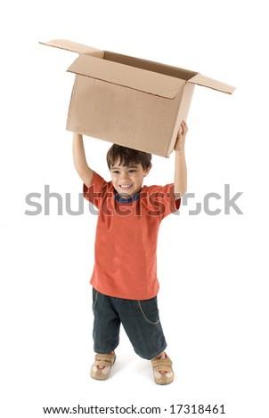 Child lifting a box on white background . - stock photo