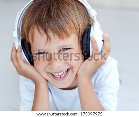 Child listens to music - stock photo