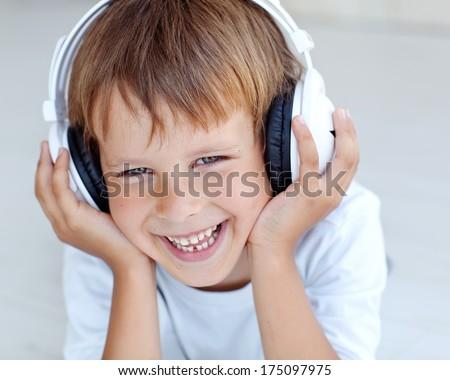Child listens to music - stock photo