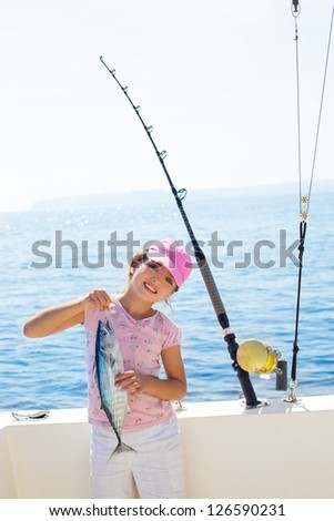 Caribbean children stock images royalty free images for Tuna fishing pole