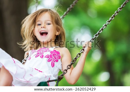 Child. Little Girl Swinging - stock photo