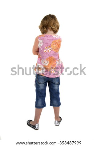 Child- little girl was offended. Shooting in the Studio on a white background. Rear view. - stock photo