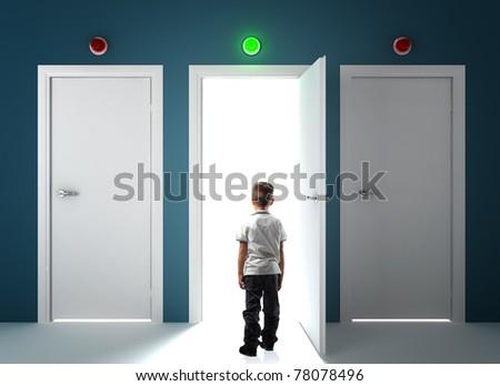 child look the bright door - stock photo