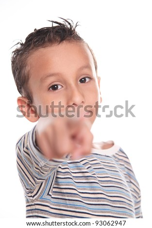 Child looking and pointing the camera, on white background