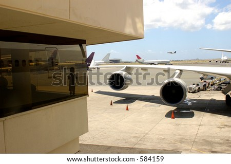 child looking at a planes from departure lounge - stock photo