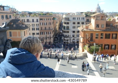 Child looking from above at Piazza di Spagna in Rome - stock photo