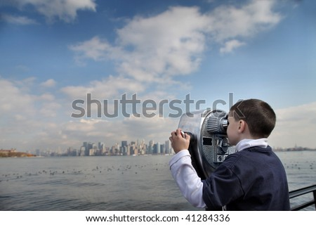 child looking new york with binoculars - stock photo