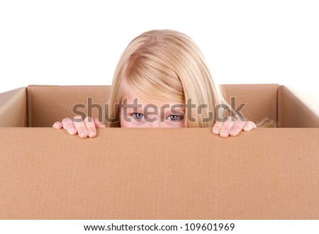 child looking out of a box isolated on white
