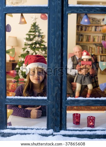 Child looking outside on Christmas eve. - stock photo