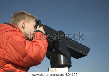 Child looking through binocular - stock photo