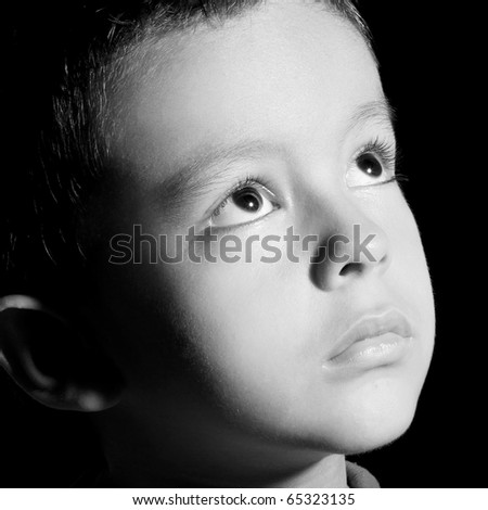 Child looking up, black and white image, close up image - stock photo