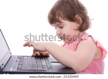 Child looks at laptop