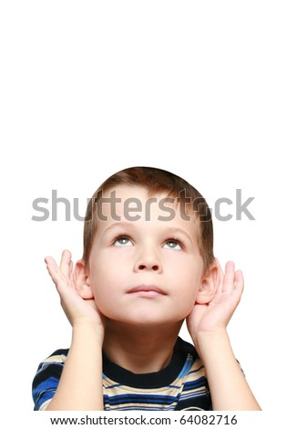 child looks up and listen - stock photo