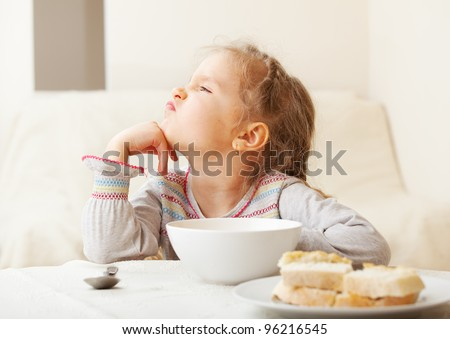Child looks with disgust for food. - stock photo