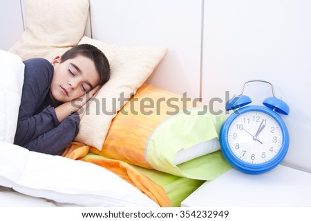 child lying in bed - stock photo