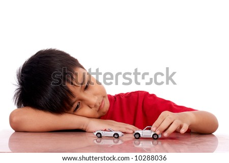 child lying on the table while playing - stock photo