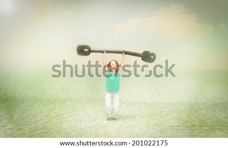 child made weight lifting with sport equipment - stock photo
