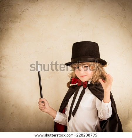 Child magician. Kid holding magic wand. Success concept - stock photo