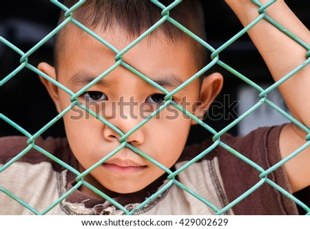 Child making a sad face - stock photo