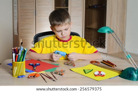 Child making Christmas decorations. Make decoration with your own hands. Handmade. - stock photo