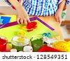 Child making decoration card with bow. - stock photo