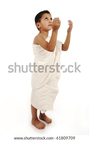 Child muslim pilgrim in white traditional clothes isolated - stock photo