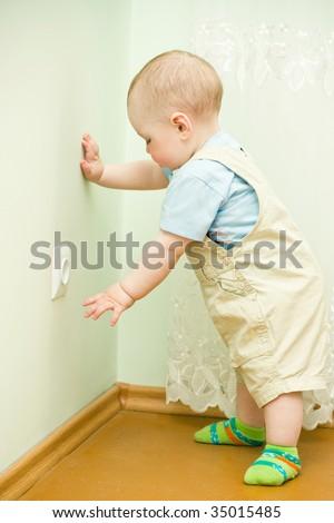 child near the socket - stock photo