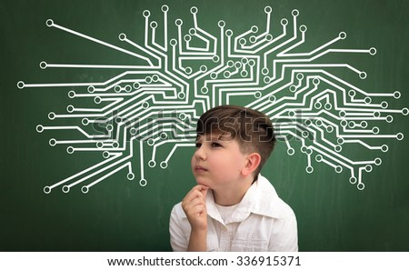 Child of  high technology thinking  like microchip, microchip sketch behind on blackboard - stock photo