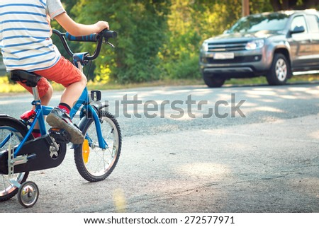 child on a bicycle at asphalt road - stock photo