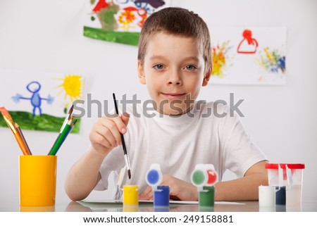 Child on a drawing class - stock photo