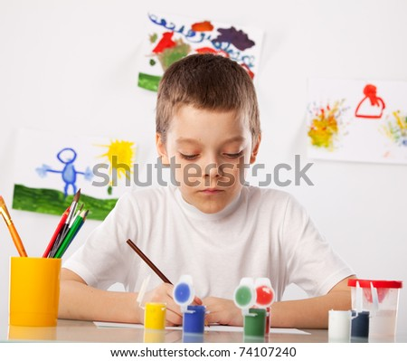 Child on a drawing class