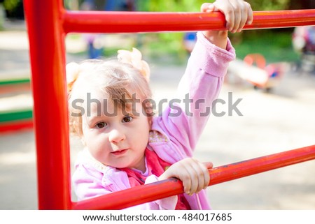 child on a playground ladder