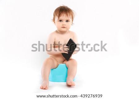 child on a potty on a white background - stock photo