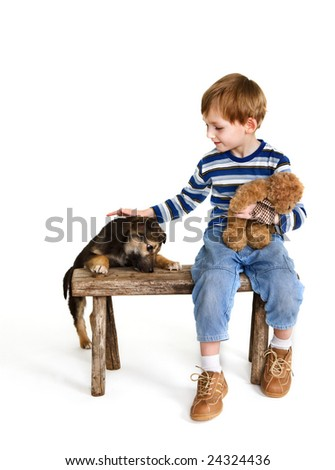Child on bench and puppy - stock photo