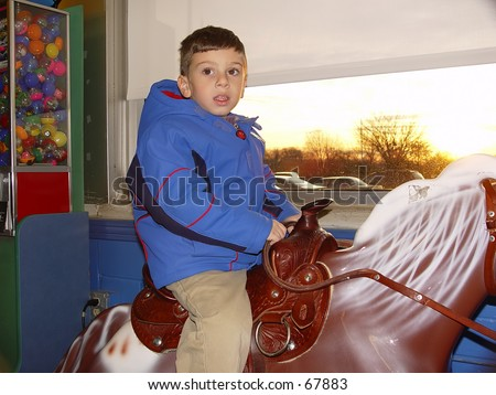 Child on Horse Ride at Store