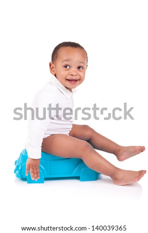 Child on potty play isolated over white - stock photo