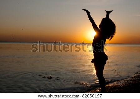 Child on sunset beach - stock photo