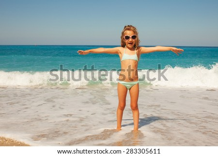 Child on the beach. Girl at vacations on sea - stock photo