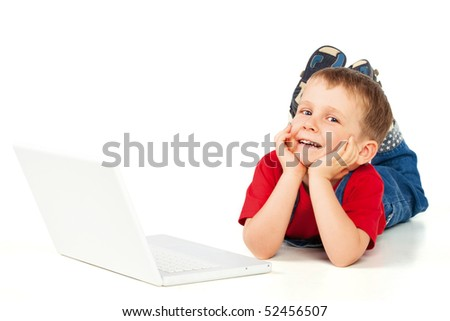 Child on the floor with laptop on white background - stock photo