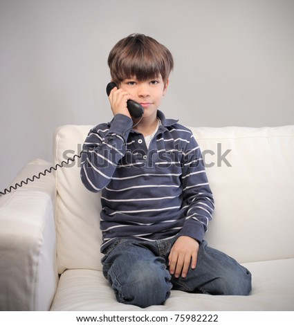 Child on the phone at home - stock photo