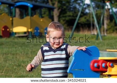 Child on the playground - stock photo