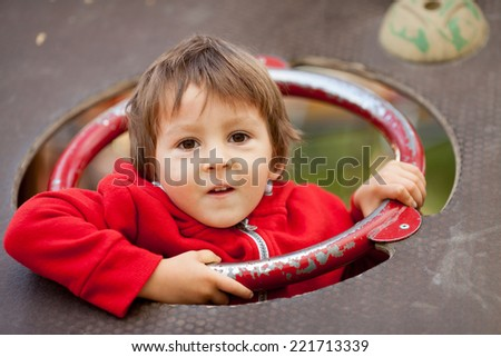 Child on the playground, having fun - stock photo