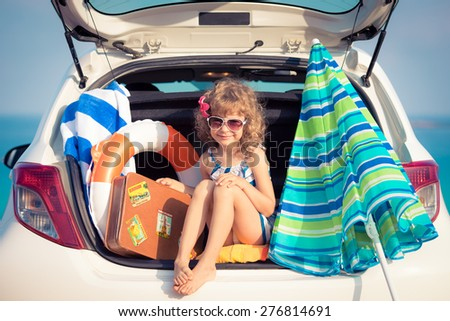 Child on vacation. Summer holiday and car travel concept - stock photo